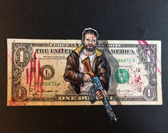 Rick Grimes painted on a dollar bill