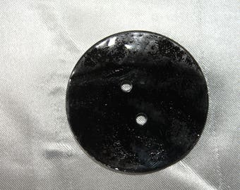 very, large, button, black, shiny, 50mm in diameter