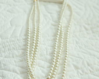 Three Layer pearl beaded Necklace with some Gold