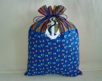 Boats at sea and marine anchor on a bag for him