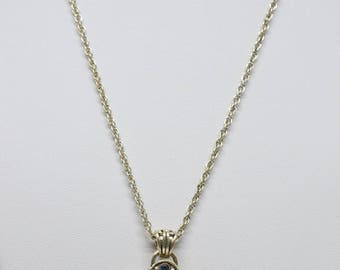 Silver tone necklace with cross