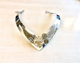 Asymetric steampunk necklace with cogs, old watch mecanism and angel wings