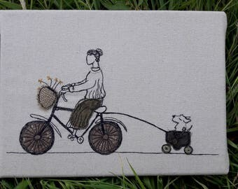 Sybil takes Lottie for a ride - machine stitched and applique wall art.