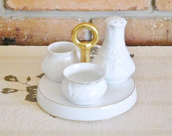 Devon Ware Fielding's Stoke on Trent 1918 white and gold porcelain cruet set with pepper shaker, open mustard and jam pots