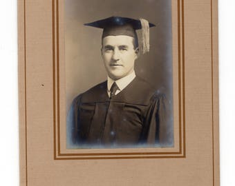 Antique graduation photo in folder