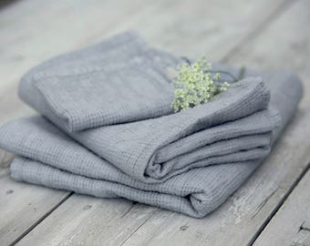 Light grey linen waffle bath towels. Hand, face and body towels. Washed linen travel towel. Stone washed linen bath sheet.