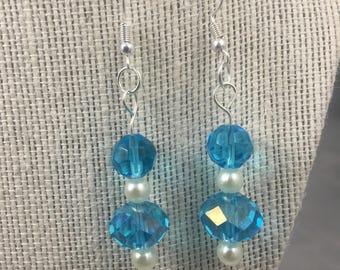 Earrings. Opaque blue beaded dangle earrings. Pearls. (548)