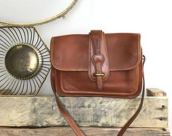 Authentic Vintage Dooney & Bourke Brown Pebbled All Weather Leather Flap Closure Shoulder Bag