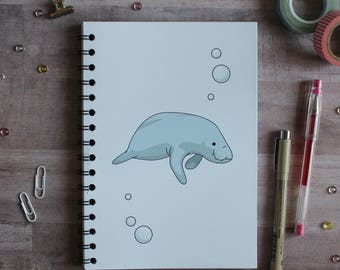 NOTEBOOK. A5 Cute Manatee Spiral Notebook. Soft 300 gsm Card Cover. 120 lined pages. Matte lamination pleasant to the touch.