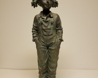 Statue of young girl in overalls and pigtails
