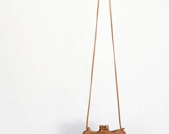 light brown mini faux leather messenger / cross-body bag with wooden closure