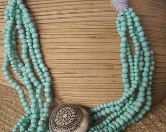 Turquoise coloured wooden bead and t-shirt yarn necklace