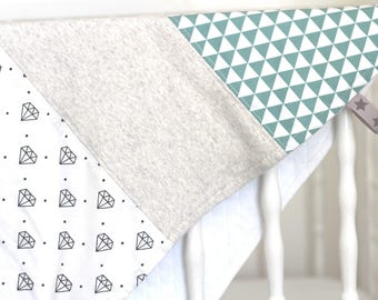 Diamonds and triangles baby blanket ideal for mid-season
