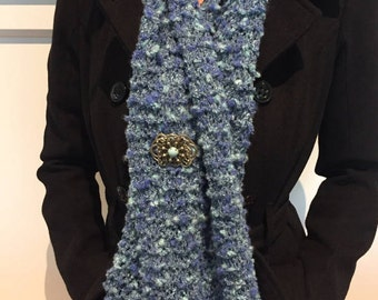 Knitted blue scarf. Extra long for versatility!  Brooch included.
