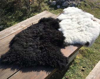 Two large genuine sheepskin rugs from Bosnia / 57 / 60