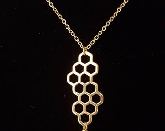 Gold Honey comb with a bee charm necklace