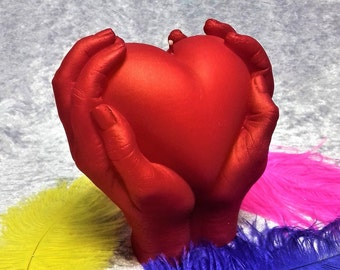 Heart in hands shaped candle