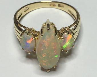 14 karat gold 3-stone Opal Ring
