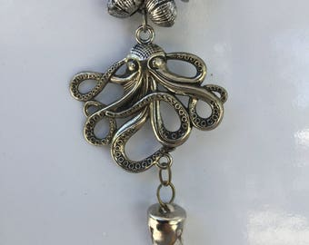 Octopus and crystal pendant necklace with wooden/silver bead string