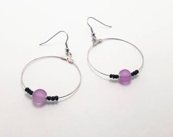 Silver hoop earrings and purple and black beads