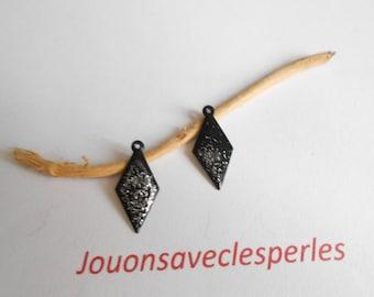 4 glittery black enamelled pendants two-faced