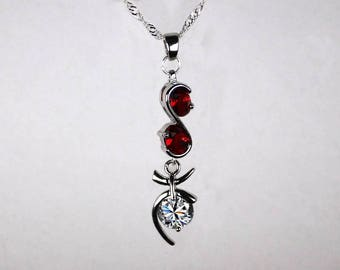 "Necklace ""Flames of Topaz, Garnet infinity Max"""
