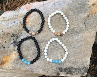 Matte black or white marble beaded bracelet with earth tone or light blue accent beads