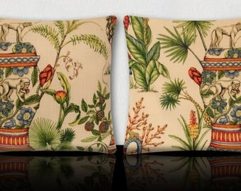 DUO of cushions square vase oriental/small monkeys/fruits, flowers and foliage, exotic green/orange/turquoise/yellow on ivory background.