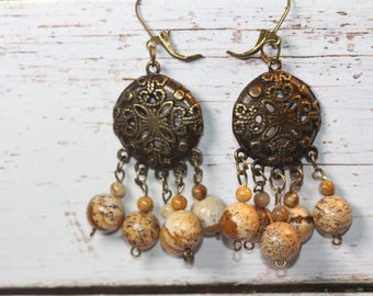 Earrings openwork bronze connector and small perless stones color wood
