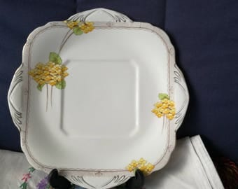 Art deco, 1930's, bone china, white cake plate by A B J Grafton of England, with yellow flower detail and gold gilt edging.