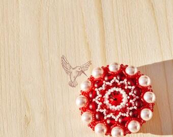 Round red brooch with swarovski elements