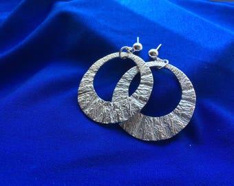 Sterling silver dangle earrings, circular