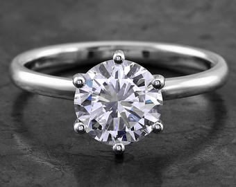 Handmade solitairering with a brilliant cut diamond 1.5 ct.