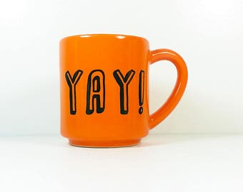 "15oz coffee mug/ tea mug with giant ""YAY!"" on both sides, shown here in Creamsicle glaze. Ready to Go"