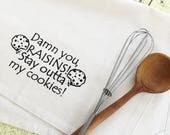Damn you raisins stay outta my cookies organic kitchen dish towel. Silk screened cotton tea towel.