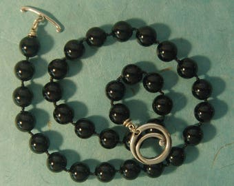 Hand knotted black onyx gemstone beads and sterling silver necklace