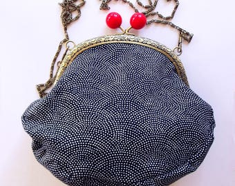 Frame purse with white spots on navy Japanese wave print, red bobbles and chain - ready to ship