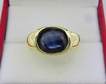 AAA  Blue Australian Sapphire 2.78 carats  10.3 x 8.2mm in 14K Yellow gold bezel set ring. 0259