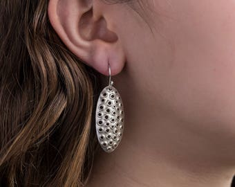 Sterling silver dangle earrings, perforated ovals, shiny, 38mm tall.
