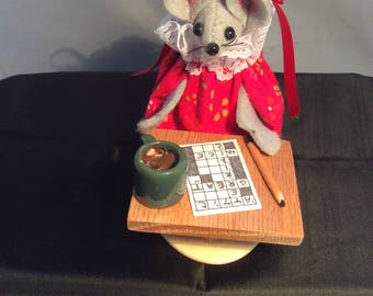 Mouse doing a Crossword Puzzle