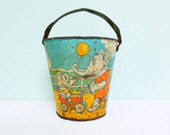 1940s Shabby Tin Toy Sand Pail Bucket with an Ocean Scene and Animals on a Boardwalk by J. Chein, Made in U.S.A.