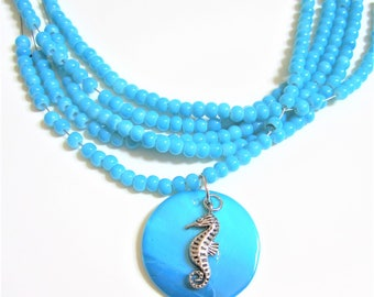 seahorse necklace on aqua teal blue shell with aqua teal blue beads