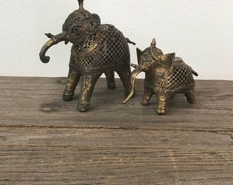 Pair of vintage Asian elephant gold metal or brass taper candle holders