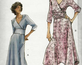 Sewing Pattern Vogue 7820 Semi fitted dress crossover bodice wide waistband kimono sleeves flared asymmetric hem skirt Size 6-8-10 uncut