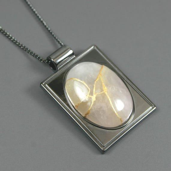 Kintsugi (kintsukuroi) rose quartz stone cabochon with gold repair in a rectangular gunmetal plated setting on gunmetal chain - OOAK