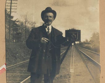Man with camera on tripod, railway tracks, Canada, Vintage photograph c1910s