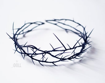 Crown of thorns on a head.