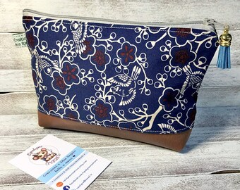 Cosmetic Bag with Japanese print of birds and flowers.