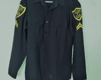 Police Uniform Shirt From Hazelton Police Department with Patches and Chevrons.