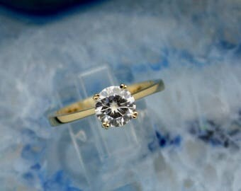 1.25 Carat Stunning 7mm Round Brilliant Moissanite Jewel Set in a Beautiful Solitaire Engagement Ring in 14 karat Rose, White or Yellow Gold